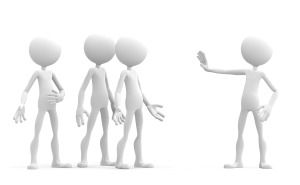3d character holding up his hand in a stop sign to warn a group of people. Isolated