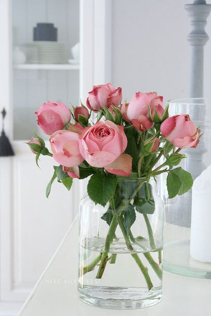 roses on clear vase